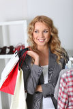 Woman in garment store Royalty Free Stock Image