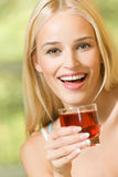 Woman with garnet juice. Woman with glass of garnet juice royalty free stock photos