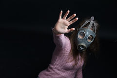Woman with gas mask Stock Images