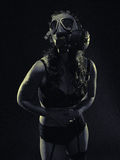 Woman and gas mask Royalty Free Stock Photo