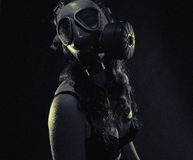 Woman and gas mask Royalty Free Stock Image