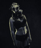 Woman and gas mask Royalty Free Stock Photography