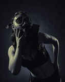 Woman and gas mask Royalty Free Stock Images