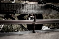Woman inside the rusty structure. Woman in the gas mask inside the rusty structure Royalty Free Stock Photography
