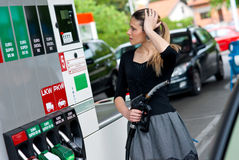 Woman in gas station Royalty Free Stock Photography