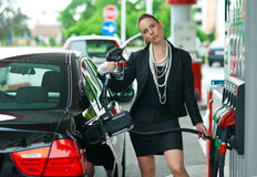 Woman in gas station Stock Photography