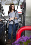 Woman at gas station Royalty Free Stock Photography