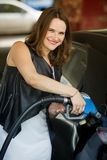 Woman at gas station refuelling her car Stock Image