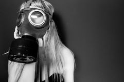 Woman in gasmask. Against wall Stock Photo