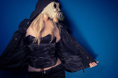 Woman in gasmask. Against wall Royalty Free Stock Photography