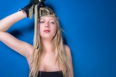 Woman in gasmask. Against dark background Stock Photo
