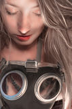 Woman in gasmask. Against dark background Royalty Free Stock Photos