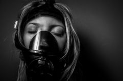 Woman in gasmask. Against dark background Royalty Free Stock Photo