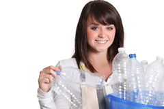 Woman gathering bottles Royalty Free Stock Photos