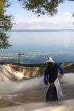 Woman Gathering Fishing Net Royalty Free Stock Photos