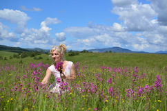 Woman Gathering Flowers on Summer Meadow