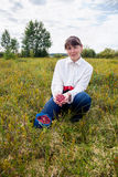 Woman gathers cranberries in a swamp Royalty Free Stock Photography
