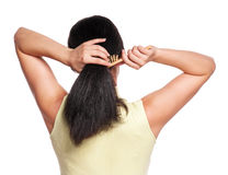 Woman gathers her hair Stock Photos