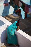 Woman on the gazebo. An woman who dressed with blue Sari is on the gazebo taken at Varanasi in India royalty free stock photography