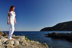 Woman gazing at evening sun Stock Images