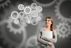 Woman and gear structure. Smiling woman and gear structure Stock Photo