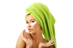 Woman with gel eye mask Stock Photos