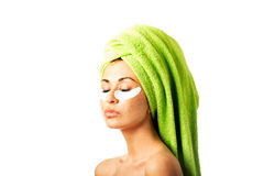 Woman with gel eye mask Royalty Free Stock Photography