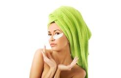 Woman with gel eye mask Stock Image