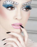 Woman with gem makeup Stock Images