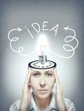 Woman generates idea. Stock Photography