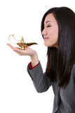 Woman with Genie Lamp. A pretty asian business woman with genie lamp dreaming Stock Photo