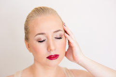 The woman with a gentle make-up and blue eyes Royalty Free Stock Images