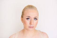 The woman with a gentle make-up and blue eyes Royalty Free Stock Image