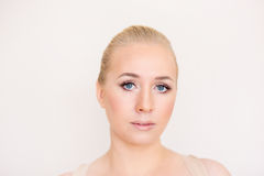 The woman with a gentle make-up and blue eyes Stock Images