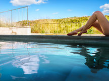 Woman in geothermal water pool of spa. Woman relaxing in natural thermal water pool of spa. Tuscany. Italy stock photo
