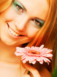 Woman with gerber flower Stock Photography