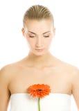 Woman with gerber flower Stock Photos
