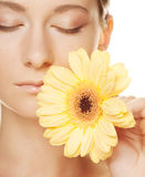 Woman with gerber flower Stock Image