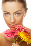 Woman with gerber flowers Stock Photography