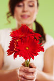 Woman with gerbera Stock Photo