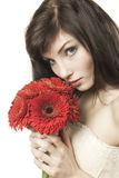 Woman with gerbera Stock Photography