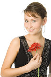 Woman with gerbera flower Royalty Free Stock Image