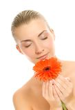 Woman with gerbera flower Stock Photography