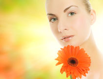 Woman with gerbera flower Royalty Free Stock Images