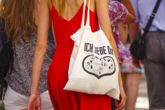 Woman with a German bag - Ich liebe dich in the streets of Lisbon Royalty Free Stock Images