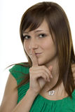 Woman with gestures quiet. A finger in front of the mouth Royalty Free Stock Images