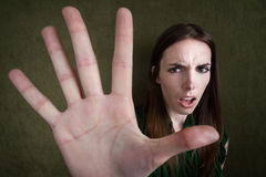 Woman Gestures Stop. Pretty Caucasian woman gestures to stop with hand Stock Images