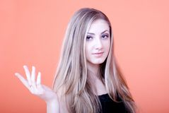Woman gesturing. Young woman gesturing, portrait royalty free stock photography
