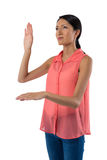 Woman gesturing against white background Stock Photos