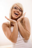 Woman gesturing. Beautiful young woman gesturing indoor royalty free stock photos